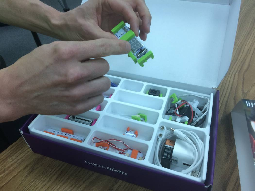 Jason Lillebo, fourth grade teacher at Edith Garehime Elementary School, points April 26, 2017, to one the components found in a littleBits kit. The component kits allow students to create electro ...