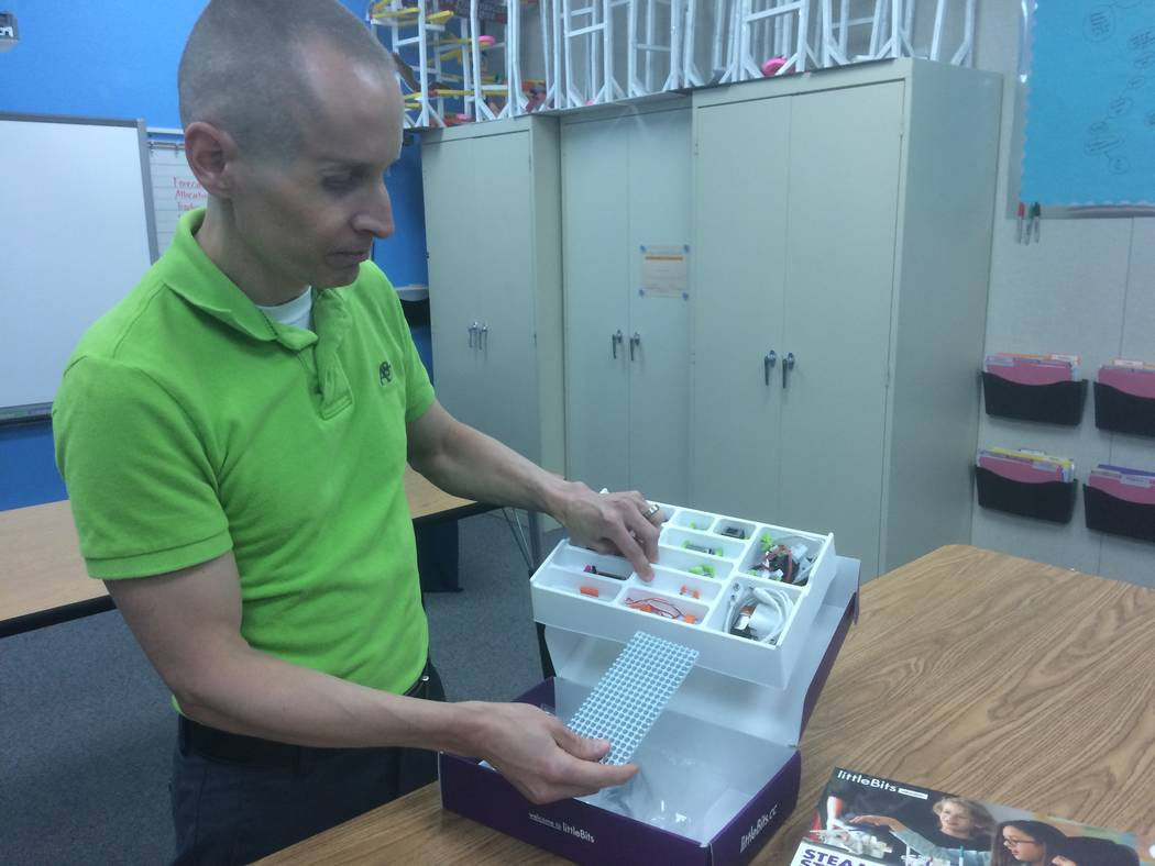 Jason Lillebo, fourth grade teacher at Edith Garehime Elementary School, shows off the components inside a littleBits kit April 26, 2017. The kits allow students to come up with solutions to probl ...