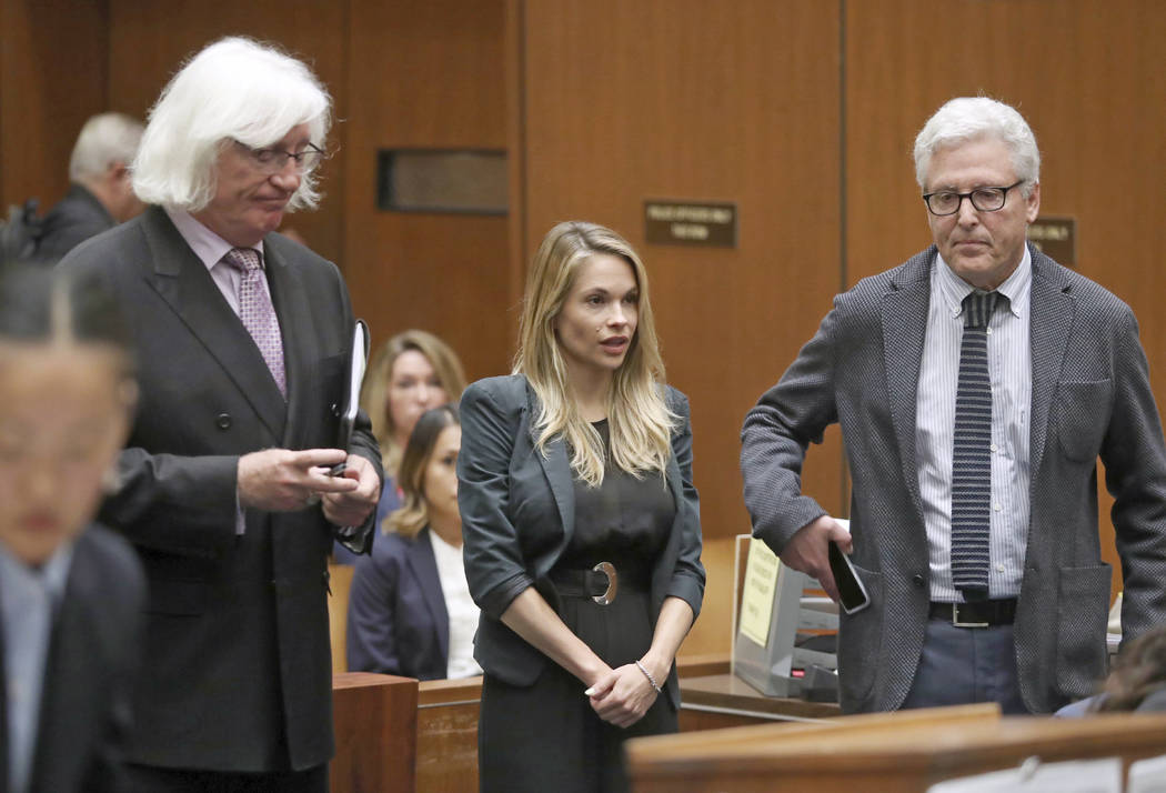 """Model and Playboy bunny Danielle """"Dani"""" Mathers, center, answers the judges's questions with her attorneys Tom Mesereau, left, and Dana M. Cole on Wednesday, May 24, 2017, in Los Angeles County Su ..."""