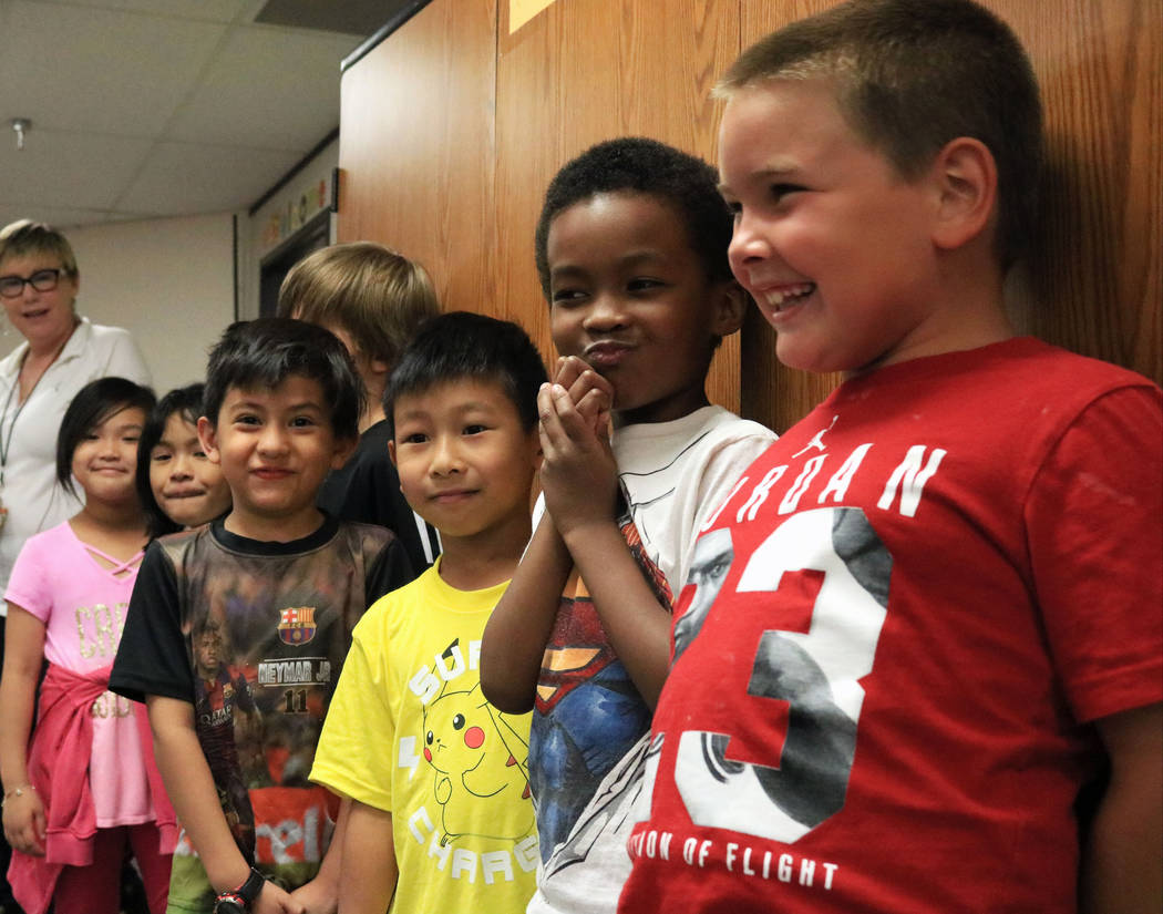 Students from Kelly Doyle's second grade class eagerly wait for the Grad Walk to start at Pat A. Diskin Elementary School, Wednesday, May 24, 2017. Gabriella Benavidez Las Vegas Review-Journal @la ...