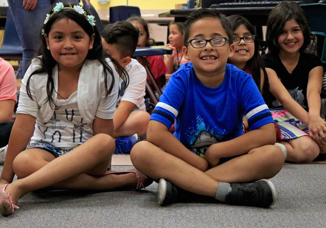 Diana Ortiz,7, left, and Christopher Chavez, 7, wait for the Grad Walk to start at Pat A. Diskin Elementary School, Wednesday, May 24, 2017. Gabriella Benavidez Las Vegas Review-Journal @latina_ish