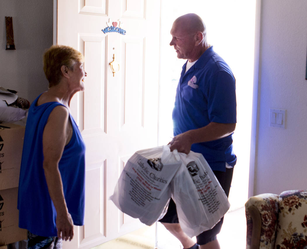 Olga Santiago greets Meals on Wheels delivery driver Steve Ivan at her home in Las Vegas, Thursday, May 25, 2017. Elizabeth Brumley Las Vegas Review-Journal @EliPagePhoto