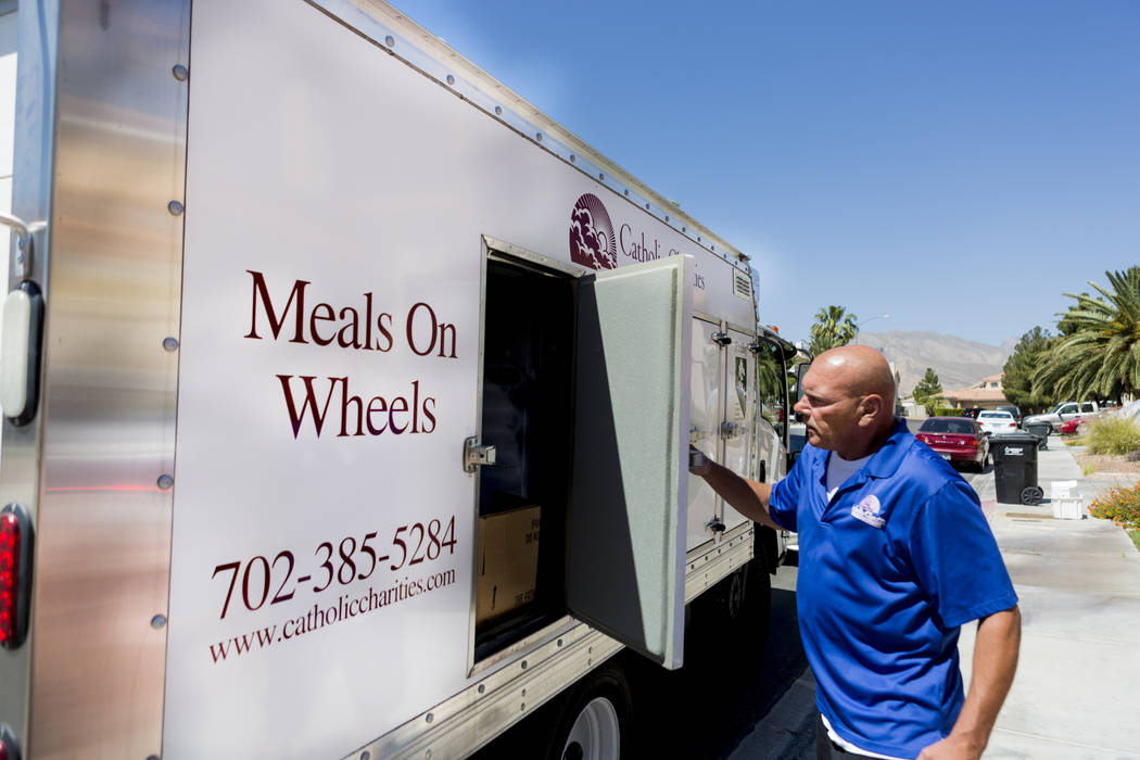 Meals on Wheels delivery driver Steve Ivan completes a delivery to Rafael Santiago-Figueroa at his home in Las Vegas, Thursday, May 25, 2017. Elizabeth Brumley Las Vegas Review-Journal @EliPagePhoto