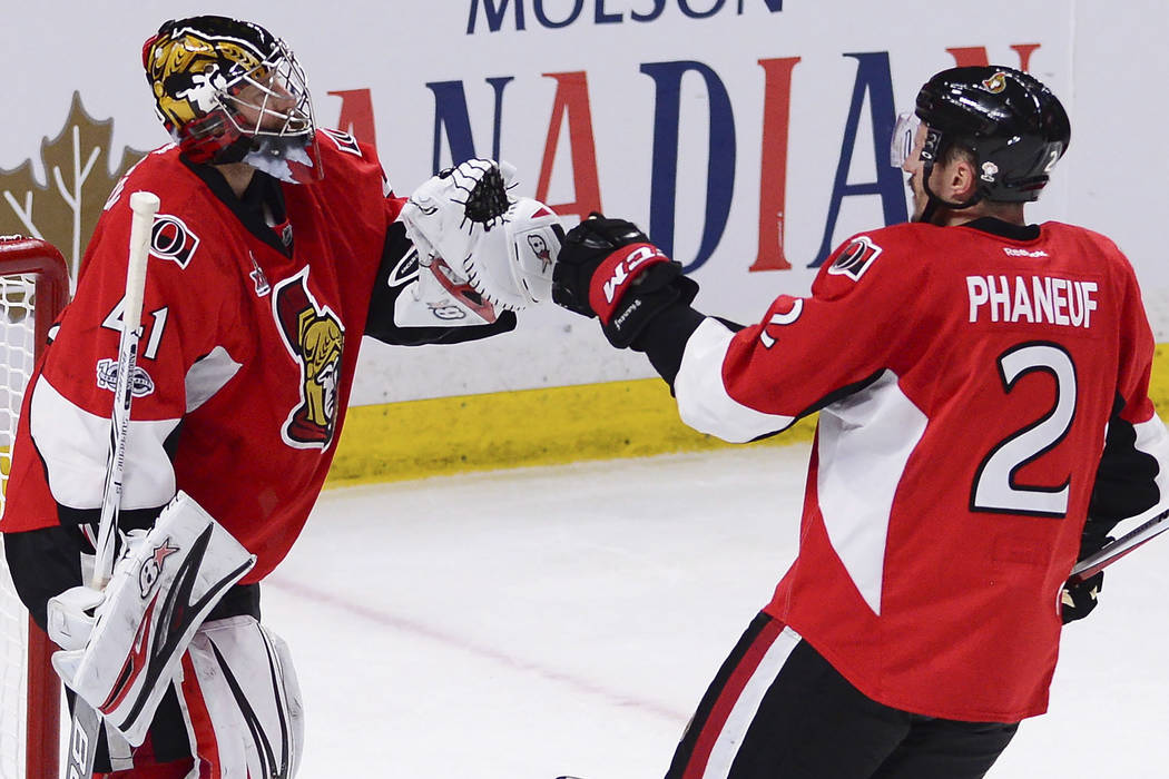 Ottawa Senators goalie Craig Anderson (41) and Senators defenseman Dion Phaneuf (2) celebrate after defeating the Pittsburgh Penguins in game six of the Eastern Conference final in the NHL Stanley ...