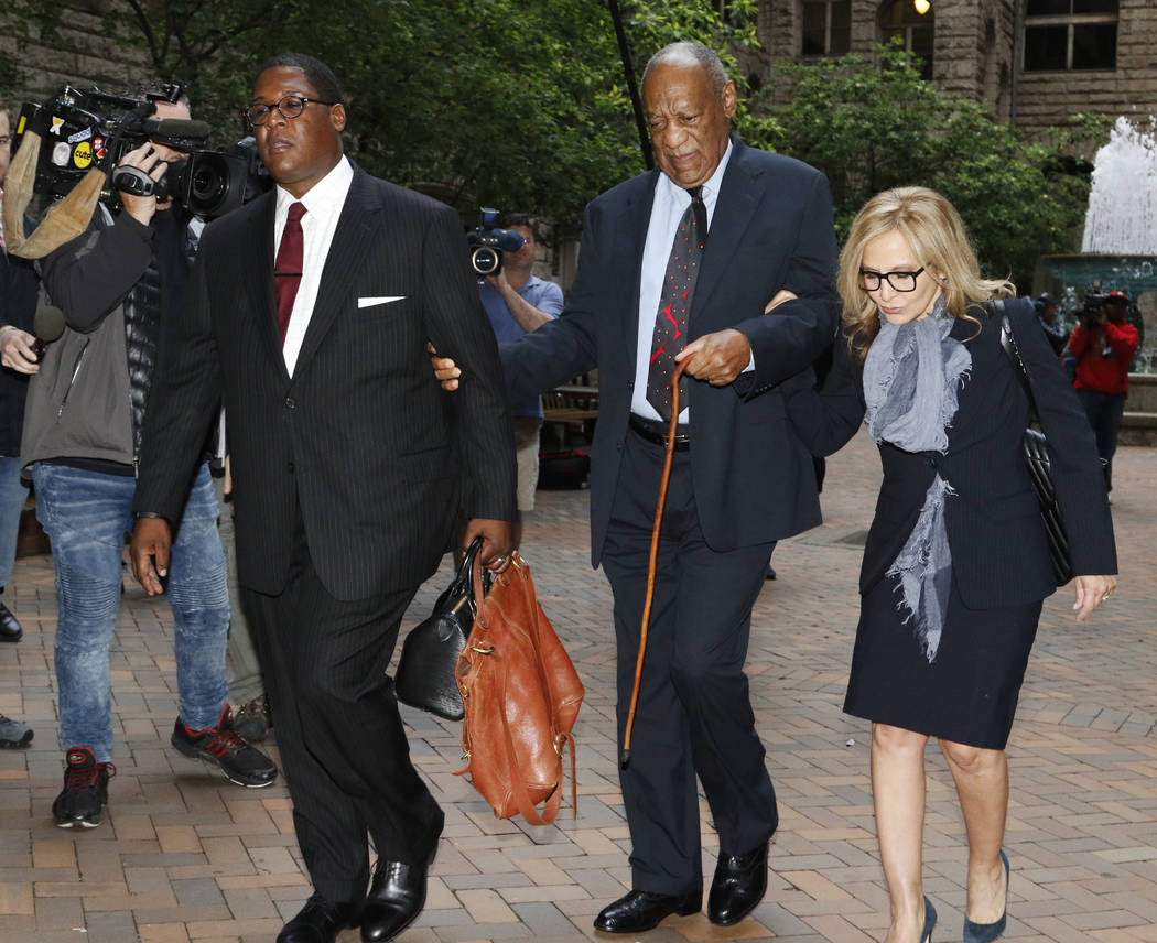 Bill Cosby, center, arrives with one of his attorneys Angela Agrusa, right, for the third day of jury selection in his sexual assault case at the Allegheny County Courthouse, Wednesday, May 24, 20 ...