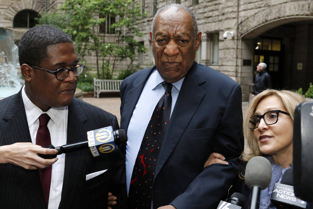 Bill Cosby, center, pauses in the courtyard as one of his attorneys Angela Agrusa, right, makes a statement to the media, as they arrive for the third day of jury selection in his sexual assault c ...