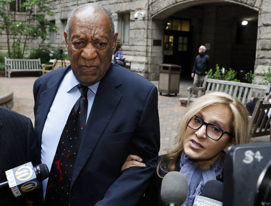 Bill Cosby, center, pauses in the courtyard as one of his attorneys Angela Agrusa, right, makes a statement to the media at the Allegheny County Courthouse, Wednesday, May 24, 2017, in Pittsburgh. ...
