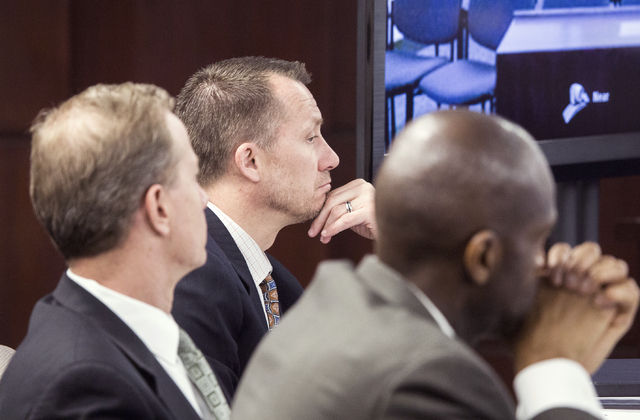 Gaming Control Board members Shawn R. Reid, left, A.G. Burnett, chairman of NGC, and Terry Johnson  during he licensure of Caesars Entertainment CEO Mark Frissora at the Nevada Gaming Commission o ...