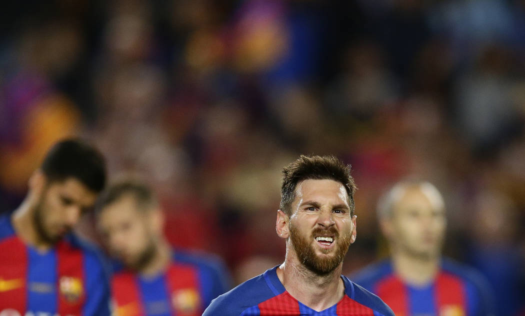 FC Barcelona's Lionel Messi reacts at the end of the Spanish La Liga soccer match between FC Barcelona and Eibar at the Camp Nou stadium in Barcelona, Spain, Sunday, May 21, 2017. (AP Photo/Manu F ...