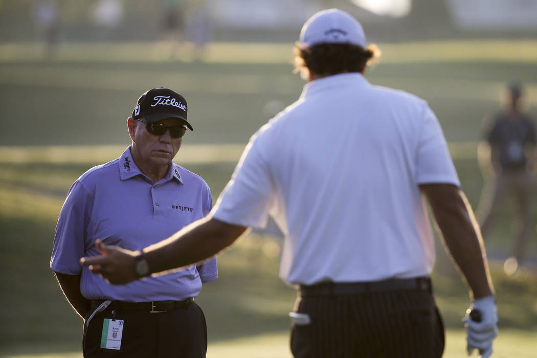 Phil Mickelson, right, talks with Butch Harmon on the practice green before a practice round for the U.S. Open golf tournament in Pinehurst, N.C., Tuesday, June 10, 2014. (David Goldman/AP)
