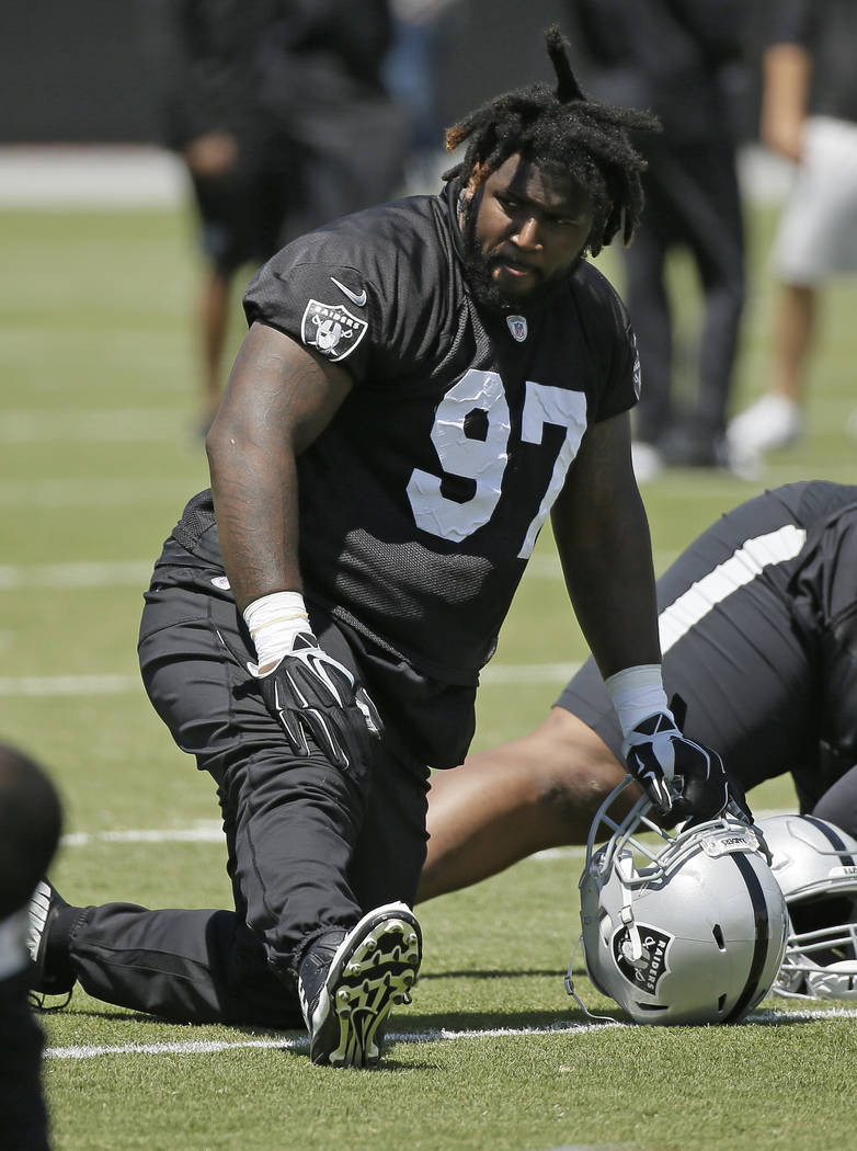 Oakland Raiders defensive end Mario Edwards stretches during their football minicamp Tuesday, June 14, 2016, in Alameda, Calif. (AP Photo/Eric Risberg)