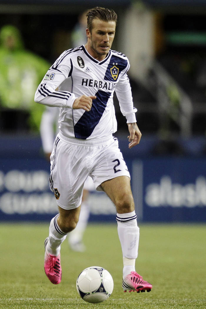 In this Nov. 18, 2012, file photo, Los Angeles Galaxy's David Beckham dribbles the ball during their MLS Western Conference championship soccer match against the Seattle Sounders in Seattle. Beckh ...