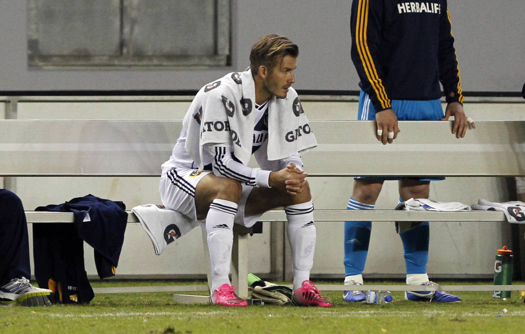 Los Angeles Galaxy midfielder David Beckham, of England sits on the bench after being replaced during the second half of their MLS playoff soccer match, Sunday, Nov. 4, 2012, in Carson, Calif. (AP ...