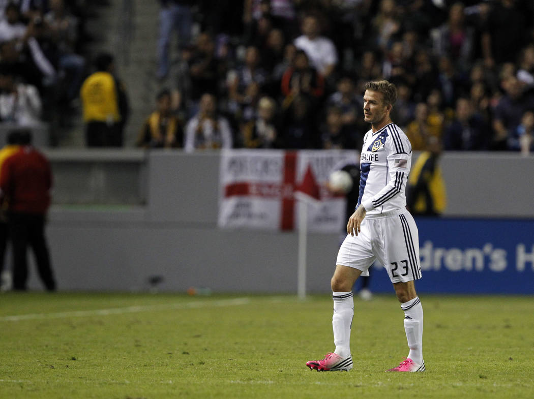 Los Angeles Galaxy midfielder David Beckham, of England, walks off the pitch to be subbed out against San Jose Earthquakes during the second half of their MLS playoff soccer match, Sunday, Nov. 4, ...