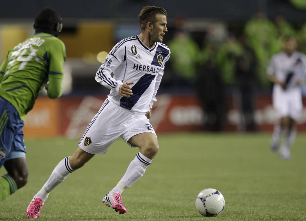 Los Angeles Galaxy's David Beckham is shown in action during the MLS Western Conference championship soccer match against the Seattle Sounders, Sunday, Nov. 18, 2012, in Seattle. (AP Photo/Ted S.  ...