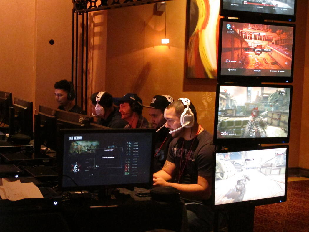 This March 31, 2017 photo shows a competitive video game tournament under way at Caesars casino in Atlantic City,N.J. Such games, called eSports, are one of several new interactive offerings that  ...