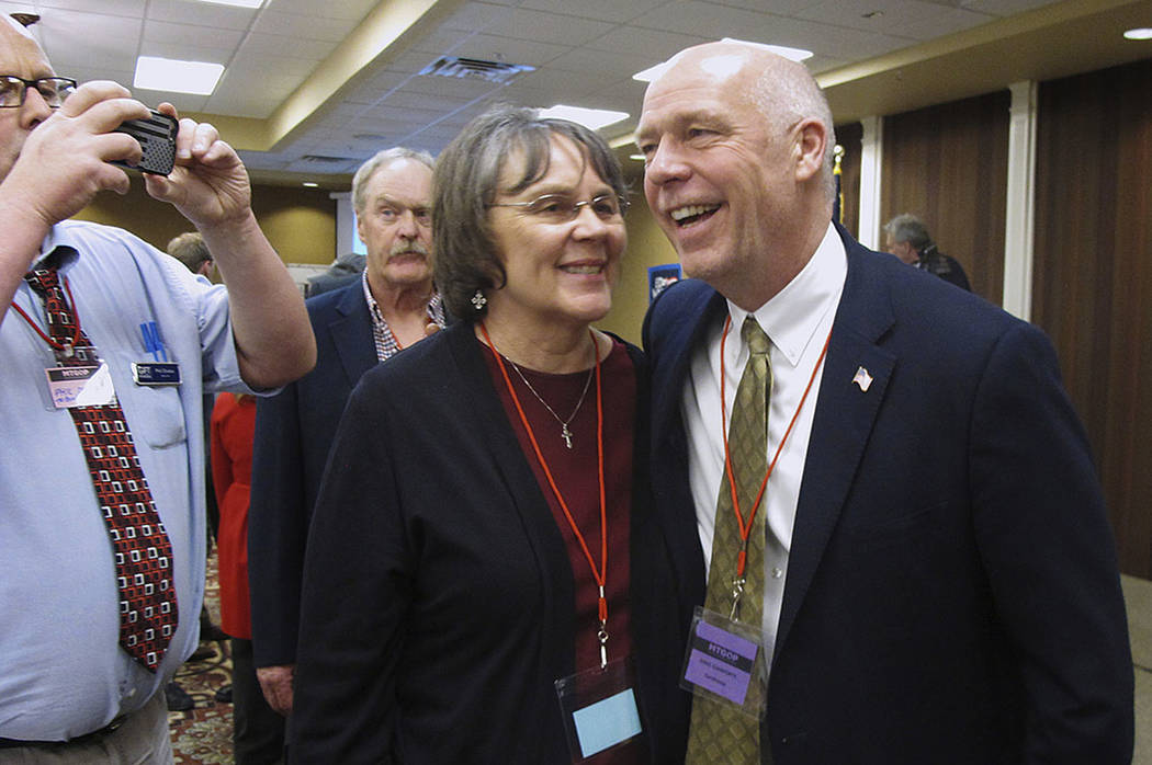 Greg Gianforte, right, receives congratulations from a supporter in Helena, Mont, in March. (AP Photo/Matt Volz, File)