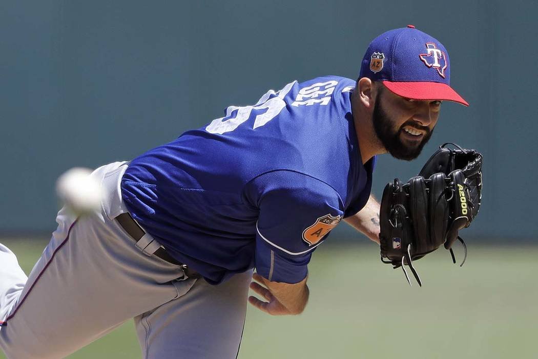 Texas Rangers' Dillon Gee throws during the third inning of a spring training baseball game against the Kansas City Royals, Wednesday, March 29, 2017, in Surprise, Ariz. (AP Photo/Darron Cummings)