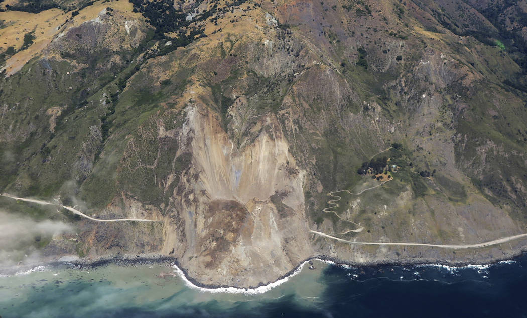 In this aerial photo taken Monday, May 22, 2017, a massive landslide along California's coastal Highway 1 that has buried the road under a 40-foot layer of rock and dirt. (John Madonna/AP)