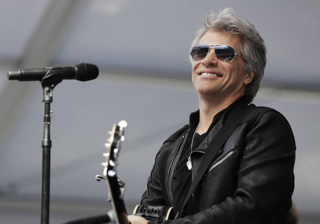 In this May 16, 2017, musician Jon Bon Jovi performs during a surprise appearance at the Fairleigh Dickinson University commencement ceremony at MetLife Stadium in East Rutherford, N.J.  (Julio Co ...