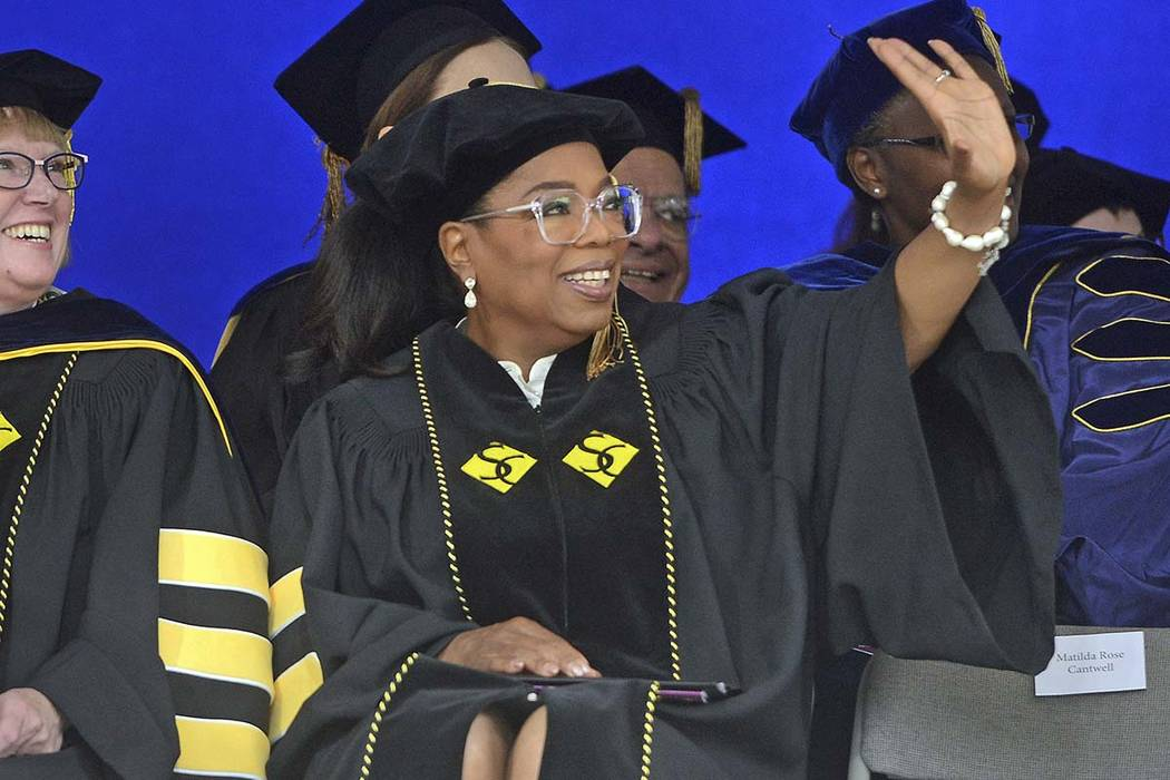 In this May 21, 2017 file photo, Oprah Winfrey waves during Smith College's 139th Commencement exercises in Northampton, Mass. Oprah Winfrey told students to live with purpose.  (David Molnar/AP)