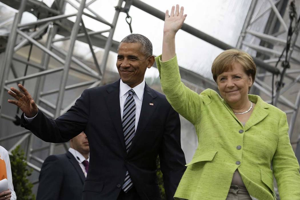 Former President Barack Obama and German Chancellor Angela Merkel arrive for a discussion event on democracy and global responsibility at a Protestant conference in Berlin, Germany, Thursday, May  ...