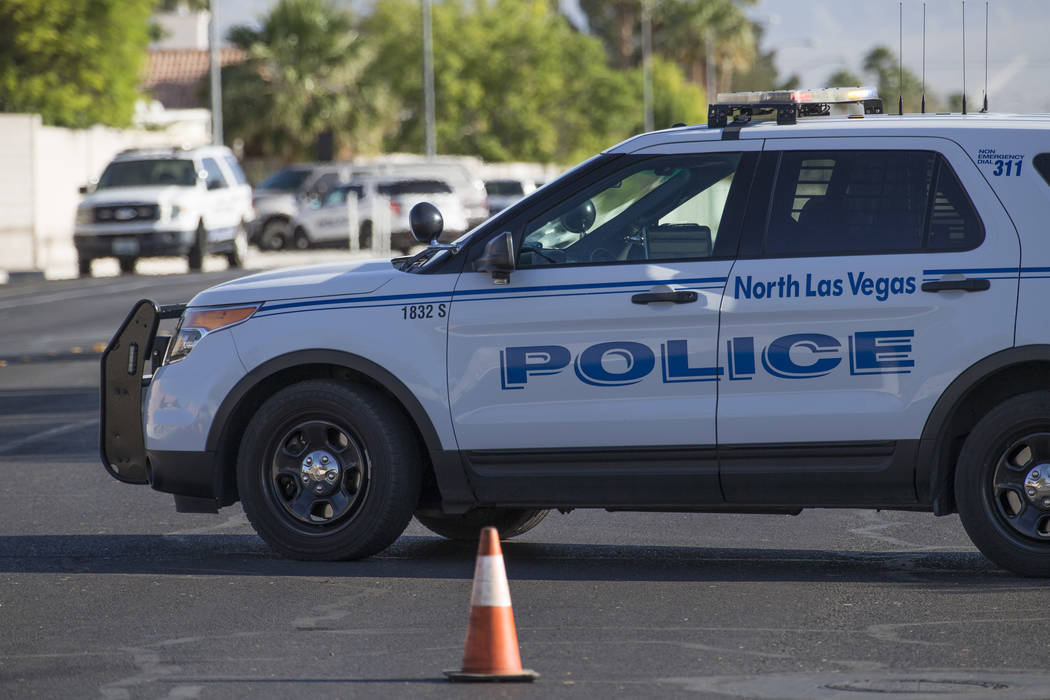 North Las Vegas police cordon off a section of Valley Rd. while investigating a barricade situation at a residence on the 3700 block of Butterball Court in North Las Vegas on Thursday, May 25, 201 ...