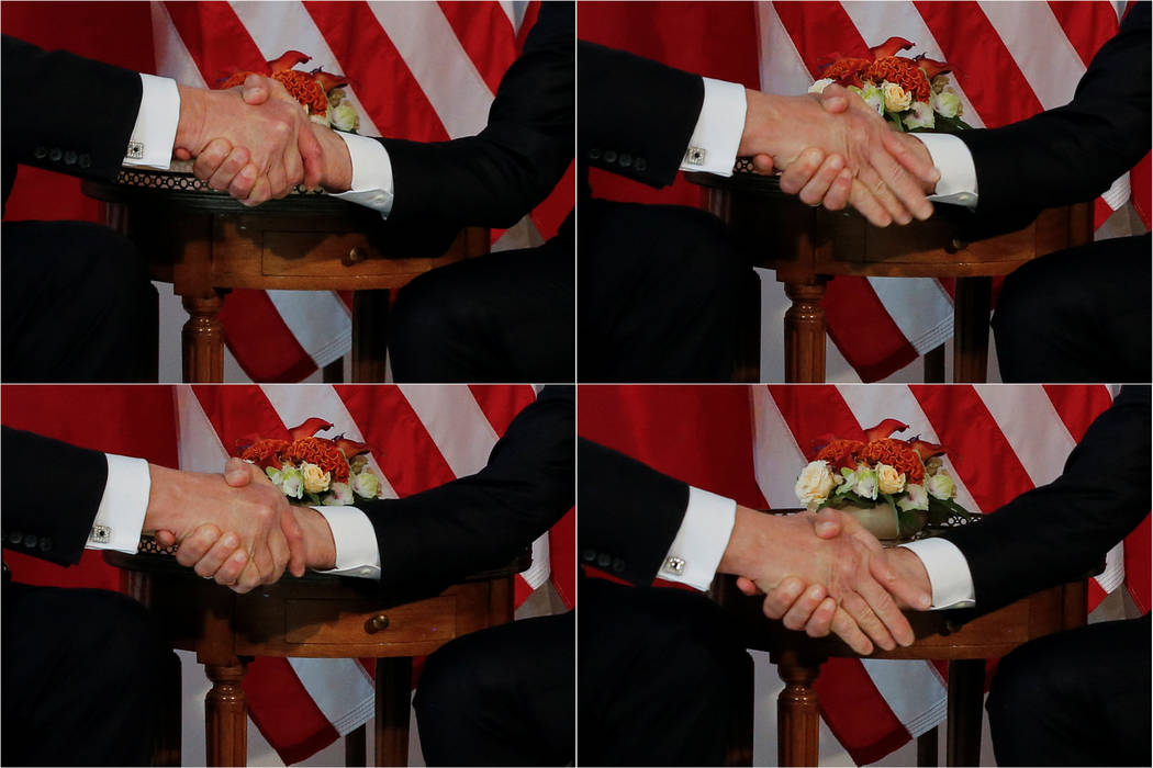A combination photo shows U.S. President Donald Trump (L) trying twice to let go of a handshake with France's President Emmanuel Macron (R) as Macron holds tight, before a working lunch ahead of a ...