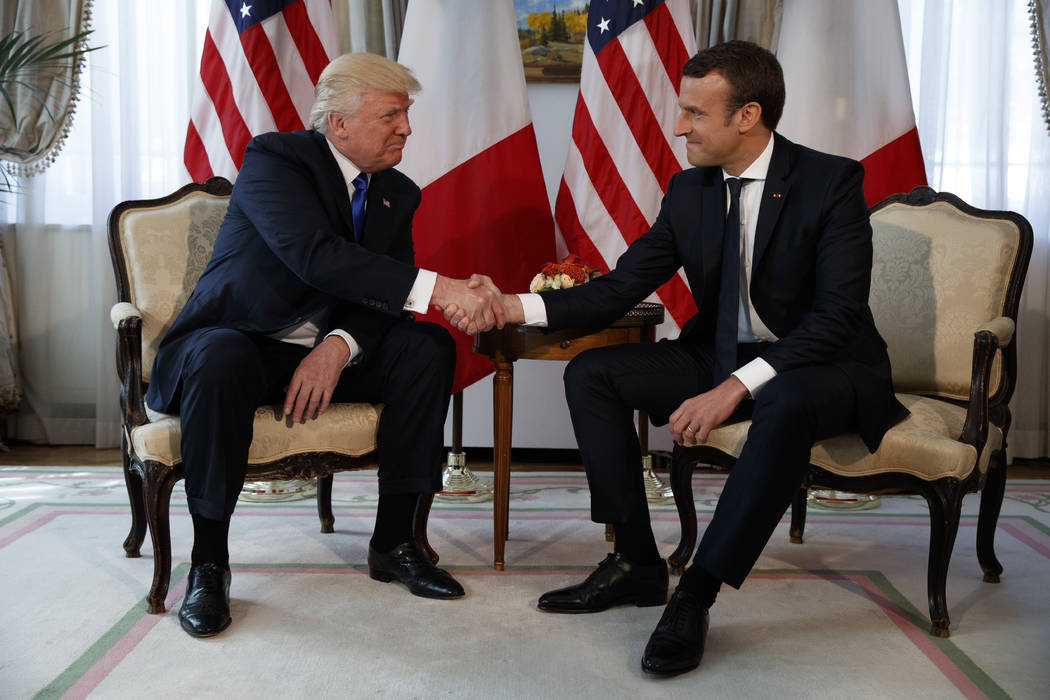 President Donald Trump shakes hands with French President Emmanuel Macron during a meeting at the U.S. Embassy, Thursday, May 25, 2017, in Brussels. (Evan Vucci/AP)