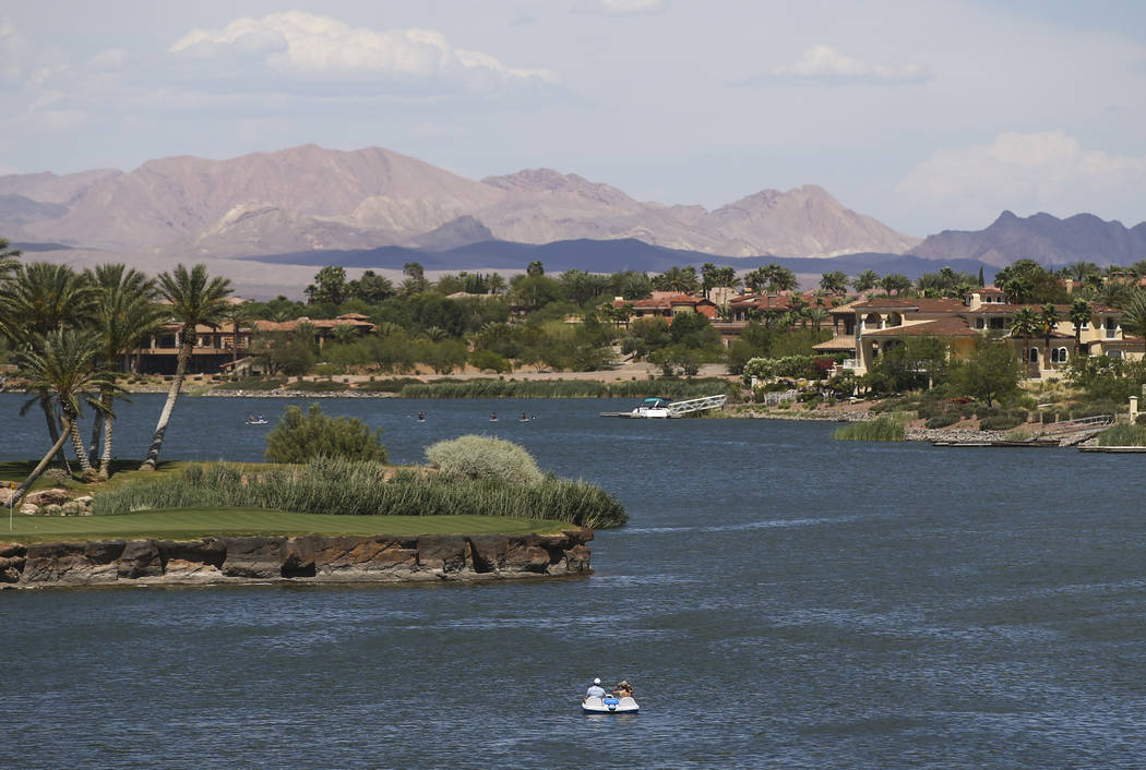 People enjoy a paddle boat at Lake Las Vegas in Henderson on Thursday, May 25, 2017. Chase Stevens Las Vegas Review-Journal @csstevensphoto