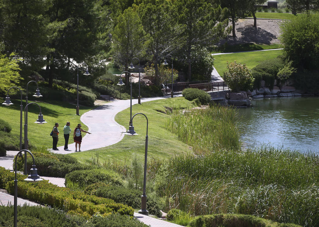 People walk along a path at Lake Las Vegas in Henderson on Thursday, May 25, 2017. Chase Stevens Las Vegas Review-Journal @csstevensphoto