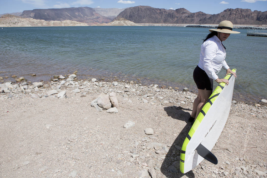Elinda grabs her paddle board to take out on the water at Lake Mead National Recreation Area near Lake Mead Marina on Thursday, May 25, 2017, in  Boulder City.  Bridget Bennett Las Vegas Review-Jo ...