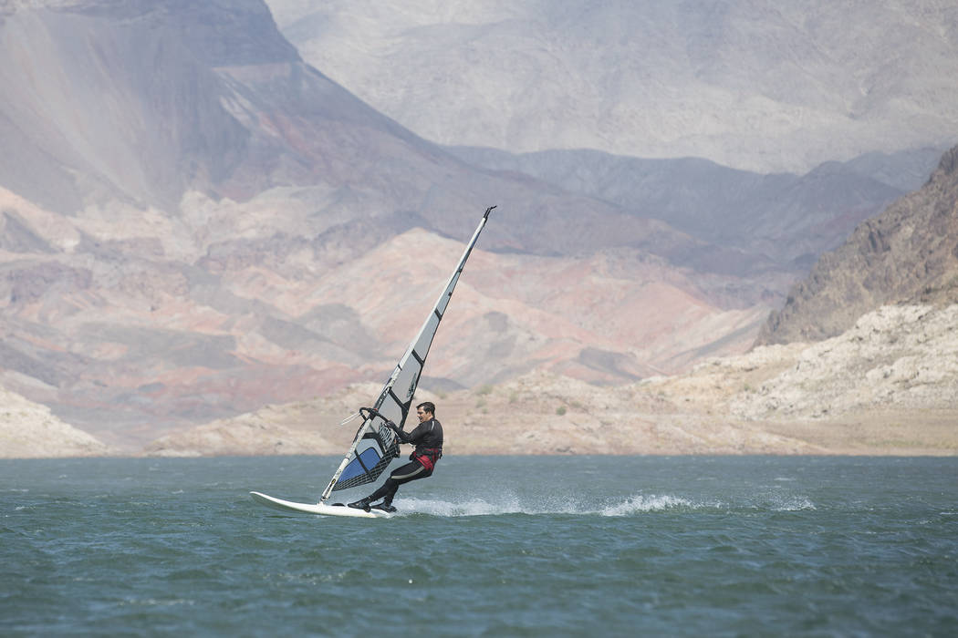 A wind surfer takes advantage of strong winds and warm temperatures at Lake Mead National Recreation Area near Lake Mead Marina on Thursday, May 25, 2017, in Boulder City.  Bridget Bennett Las Veg ...