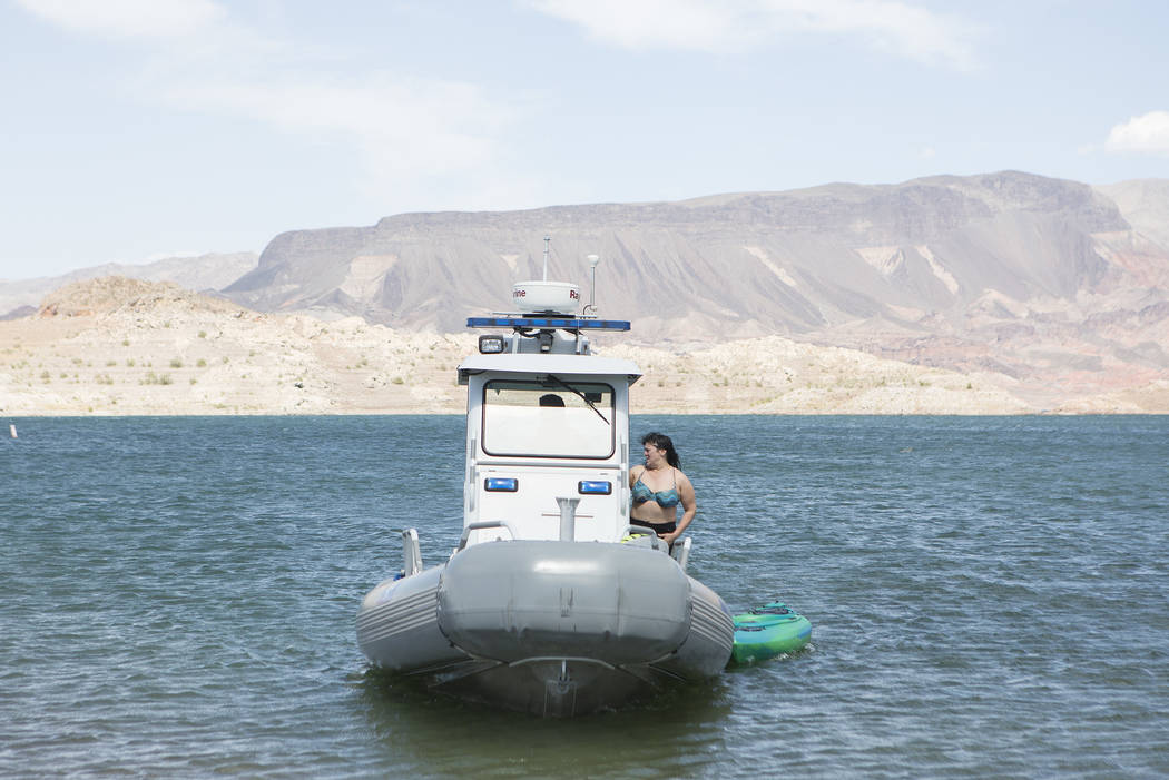 A patrol boat brings Amy Garrett, Elinda, their kayak and paddle board back to shore after being pushed out by a gust of wind at Lake Mead National Recreation Area near Lake Mead Marina on Thursda ...