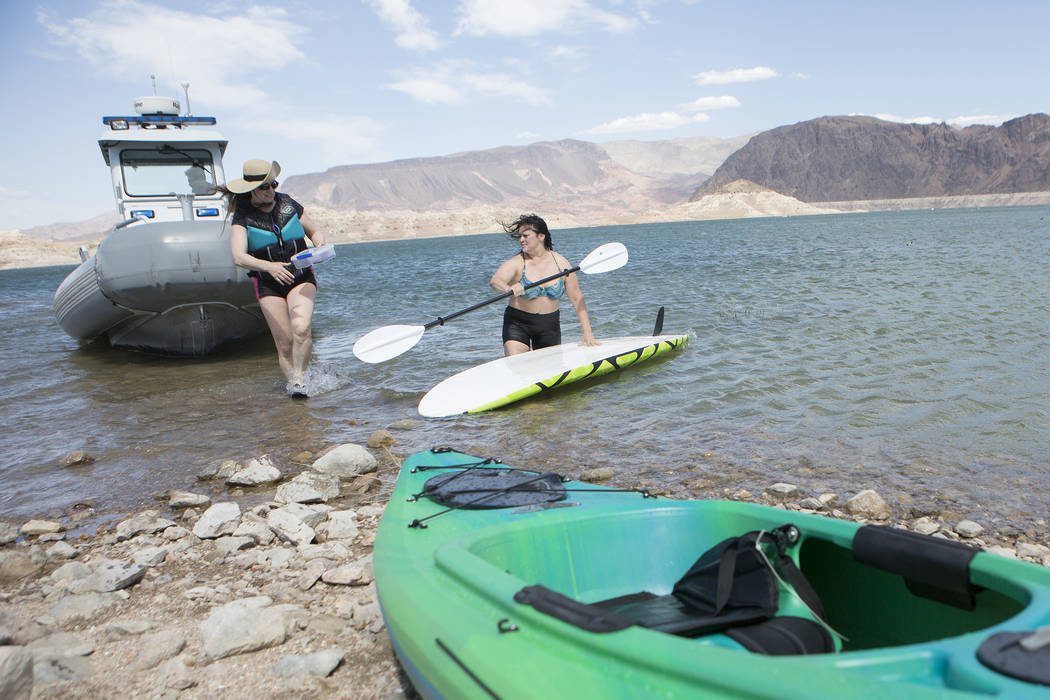 A patrol boat brings Amy Garrett, left, Elinda, right, their kayak and paddle board back to shore after being pushed out by a gust of wind at Lake Mead National Recreation Area near Lake Mead Mari ...