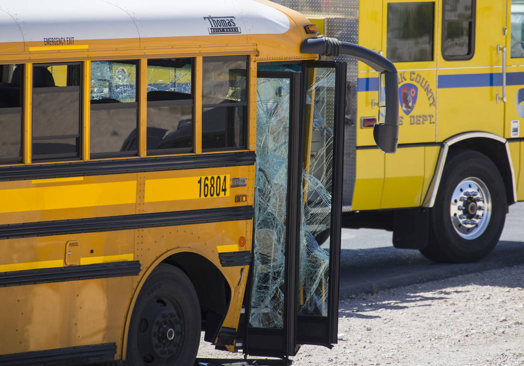 Officials investigate an accident involving a Clark County school bus on S. Fort Apache Rd. near W. Patrick Ln. on Thursday, May 25, 2017. Richard Brian Las Vegas Review-Journal @vegasphotograph