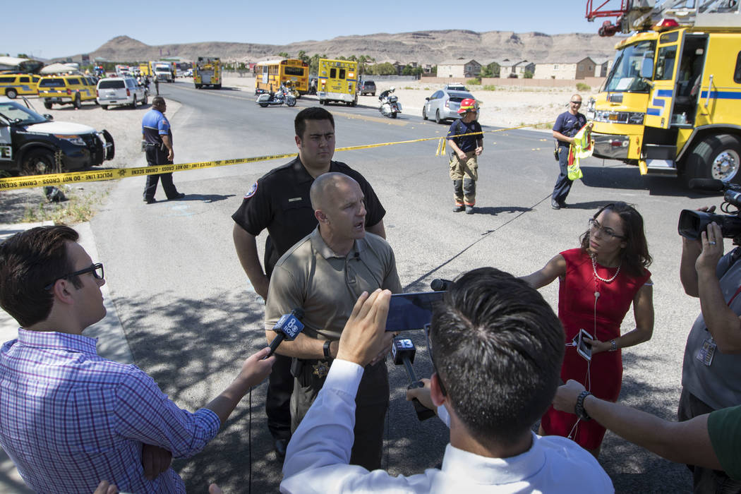 Metro Lt. Larry Hadfield briefs members of the news media following an accident involving a Clark County school bus and an SUV on S. Fort Apache Rd. near W. Patrick Ln. on Thursday, May 25, 2017.  ...