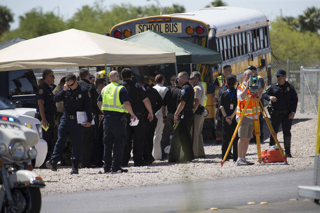 Emergency personnel gather at the scene of an accident involving a Clark County school bus and SUV on S. Fort Apache Rd. near W. Patrick Ln. on Thursday, May 25, 2017. Richard Brian Las Vegas Revi ...