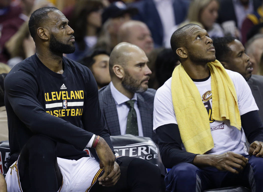 Cleveland Cavaliers' James Jones, right, and LeBron James sit on the bench against the Boston Celtics during the first half of Game 4 of the NBA basketball Eastern Conference finals, Tuesday, May  ...