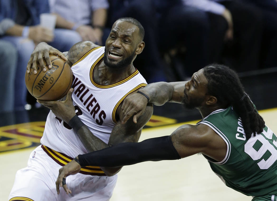 Cleveland Cavaliers' LeBron James (23) goes up for a shot against Boston Celtics' Jae Crowder (99) during the second half of Game 4 of the NBA basketball Eastern Conference finals, Tuesday, May 23 ...