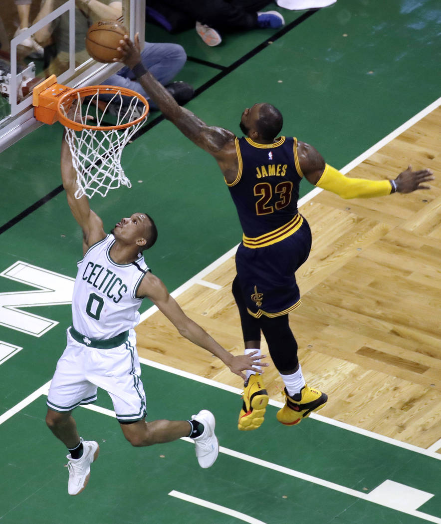 Cleveland Cavaliers forward LeBron James, right, blocks a shot by Boston Celtics guard Avery Bradley during the first half of Game 2 of the NBA basketball Eastern Conference finals, Friday, May 19 ...