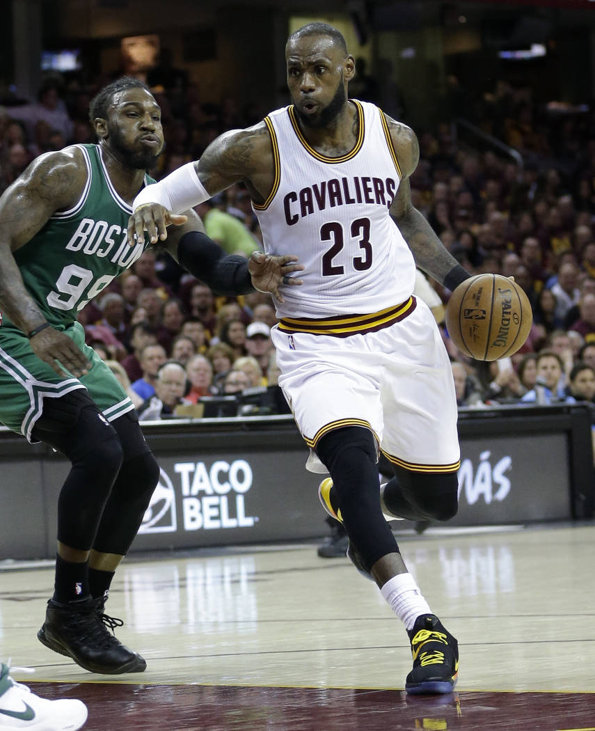 Cleveland Cavaliers' Kyrie Irving (2)3 drives on Boston Celtics' Jae Crowder (99) during the second half of Game 3 of the NBA basketball Eastern Conference finals, Sunday, May 21, 2017, in Clevela ...