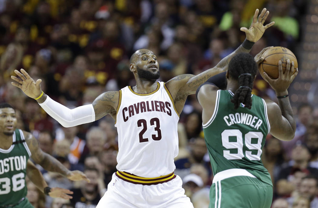 Cleveland Cavaliers' LeBron James (23) defends against Boston Celtics' Jae Crowder (99) during the second half of Game 3 of the NBA basketball Eastern Conference finals, Sunday, May 21, 2017, in C ...