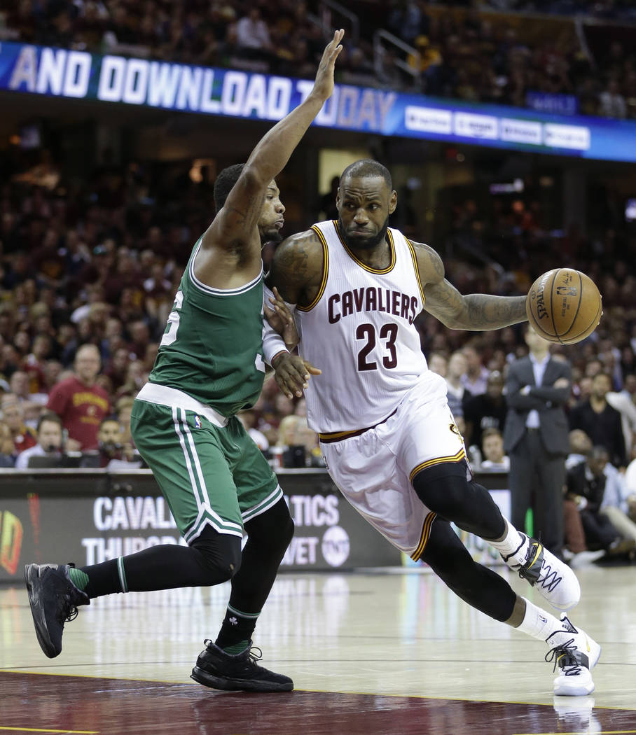 Cleveland Cavaliers' LeBron James (23) drives on Boston Celtics' Marcus Smart (36) during the second half of Game 4 of the NBA basketball Eastern Conference finals, Tuesday, May 23, 2017, in Cleve ...