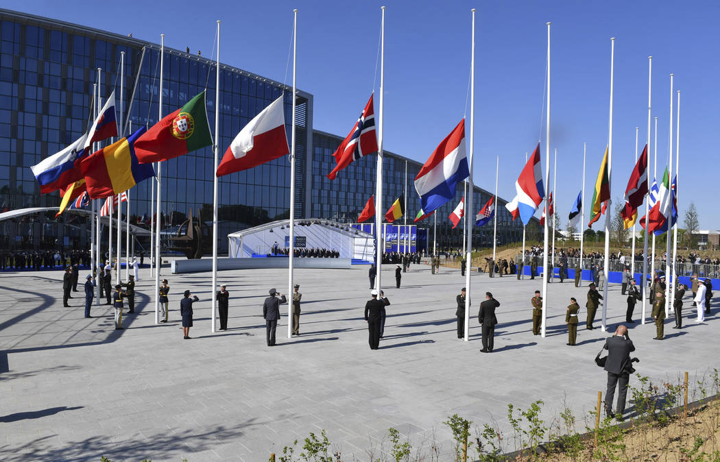 Flags of NATO member countries flutter during a handover ceremony at the NATO summit in Brussels on Thursday, May 25, 2017. US President Donald Trump and other NATO heads of state and government o ...