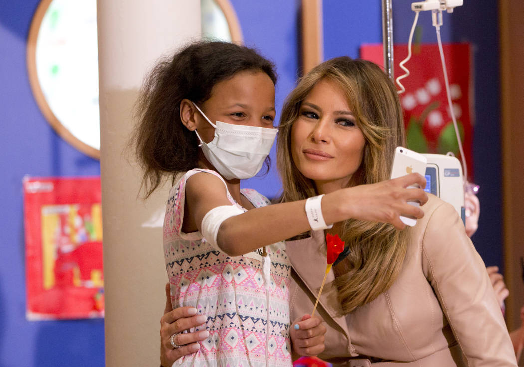A small child takes a selfie with Melania Trump, the wife of US President Donald Trump, at the Queen Fabiola Childrens Hospital in Brussels on Thursday, May 25, 2017. Melanie Trump visited childre ...