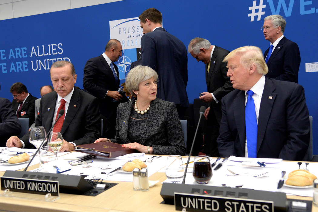 ... Donald Trump, attend a working dinner meeting during the NATO summit