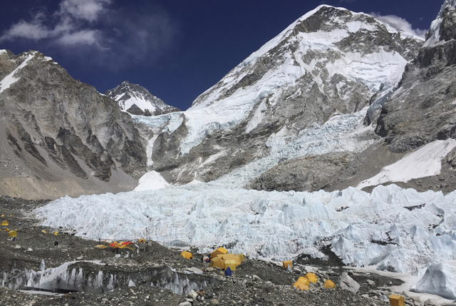 Yellow and orange tents at Everest Base Camp, pitched on the edges of the Khumbu icefall, are seen in Nepal in April 2016. (Karin Laub/The Associated Press)