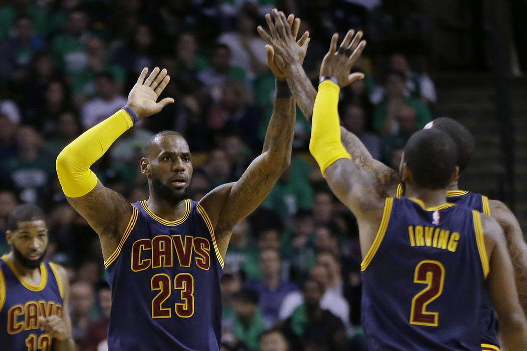 Cleveland Cavaliers forward LeBron James (23) trades high-five's with Cleveland Cavaliers guard Kyrie Irving (2) during the first half of Game 5 of the NBA basketball Eastern Conference finals aga ...