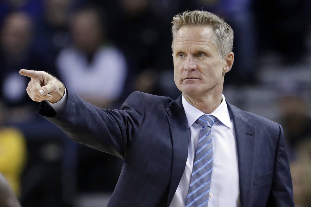 In this Monday, Nov. 28, 2016 file photo, Golden State Warriors head coach Steve Kerr directs his team during the first half of an NBA basketball game against the Atlanta Hawks in Oakland, Calif.  ...